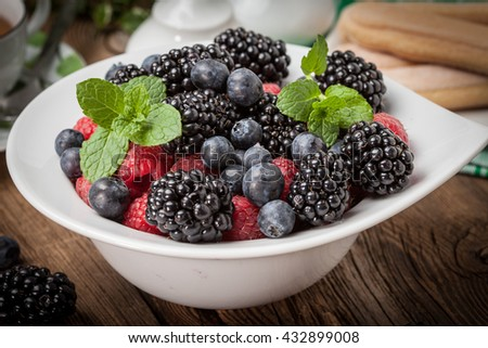 Mix of berries in a bowl. Selective focus.