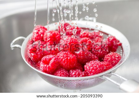 Mix of berries rinsed with water - stock photo