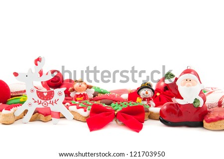 Mix of christmas decoration and cookies on white background - stock photo