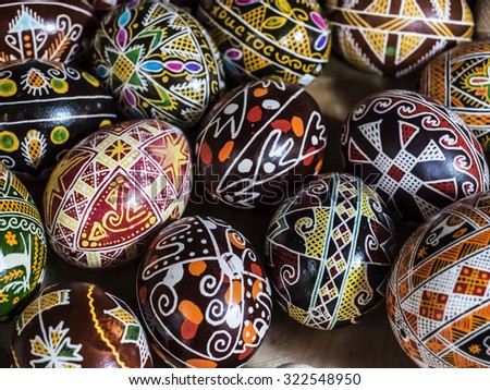 Mix of colored eggs with the traditional designs - stock photo