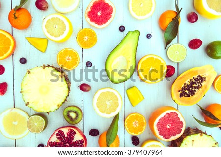 Mix of colored fruits on white wooden background - Composition of tropical and mediterranean fruits - Concepts about decoration, healthy eating and food background - stock photo