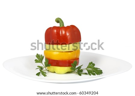 mix of colored peppers chopped isolated on white background