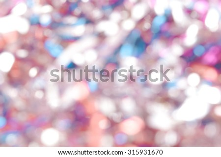 "Mix of colorful christmas decoration for the Christmas tree ""rain"". New year theme. Abstract blur defocused background. Toned. - stock photo"