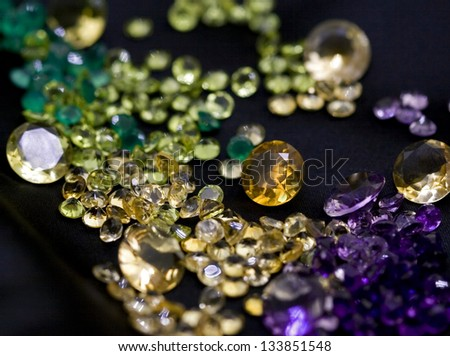 Mix of colorful gem stones on the black background. - stock photo