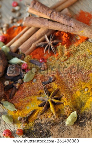 mix of colorful spices on wooden background - stock photo