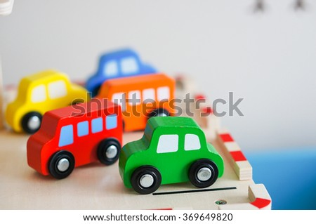 Mix of colorful wooden toy cars - stock photo