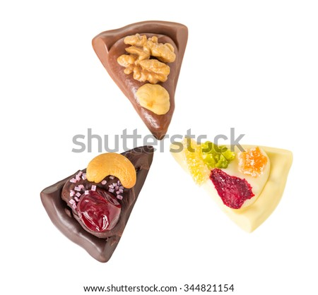Mix of delicious chocolate pizza slices with nuts and candied fruits. Isolated on a white background.