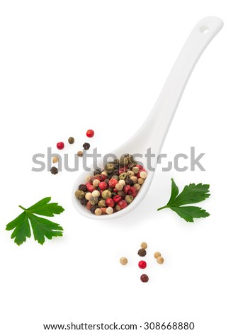 mix of different peppers in a white ceramic spoon and parsley leaves, mixture of hot pepper, red pepper, black pepper, white pepper, green pepper Isolated on white background - stock photo