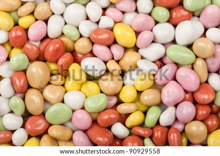 Mix of dragee, sugar covered nuts, background - stock photo