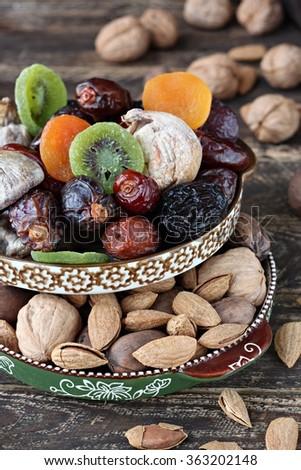 Mix of dried fruits and almonds - symbols of judaic holiday Tu Bishvat - stock photo