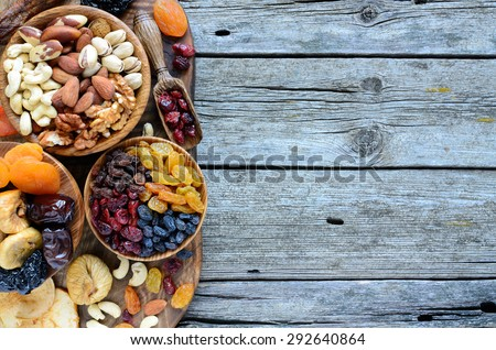 Mix of dried fruits and nuts - symbols of judaic holiday Tu Bishvat. Copyspace background. - stock photo
