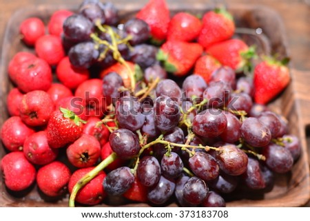 mix of fresh fruits and berries. raw food ingredients. nutrition background - stock photo