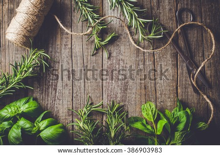 Mix of fresh herbs from garden on an old table
