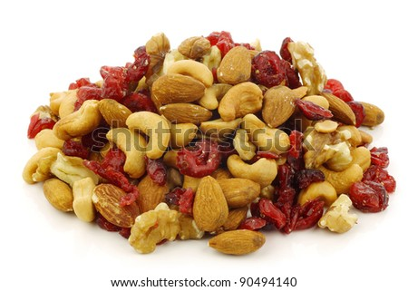 mix of fresh nuts and dried cranberries on a white background - stock photo