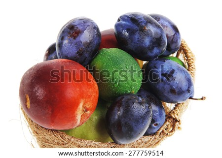 mix of fresh raw ripe juice fruits apple plum peach and lemon in basket isolated over white background - stock photo