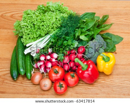 mix of fresh vegetables on wooden table - stock photo