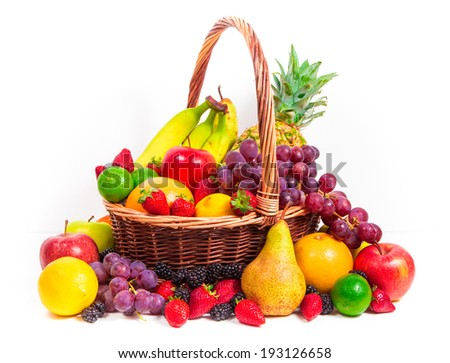 Mix of fruits in a wicker basket on white background - stock photo