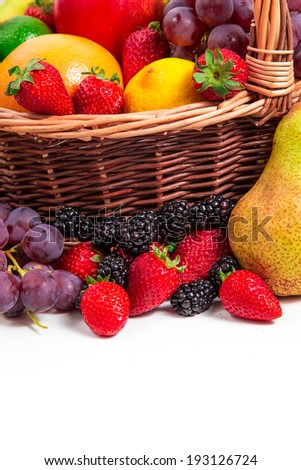 Mix of fruits in a wicker basket on white background