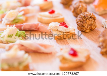 Mix of Hors D'oeuvres on a wooden platter