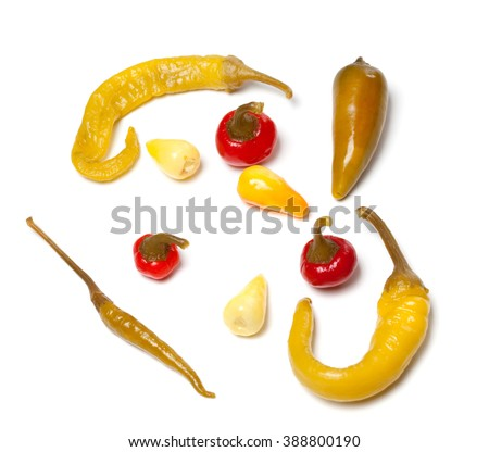 Mix of hot marinated turkish peppers. Isolated on white background. Top view. - stock photo