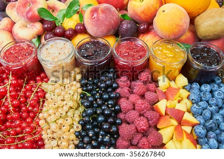 Mix of jams and fruits - stock photo