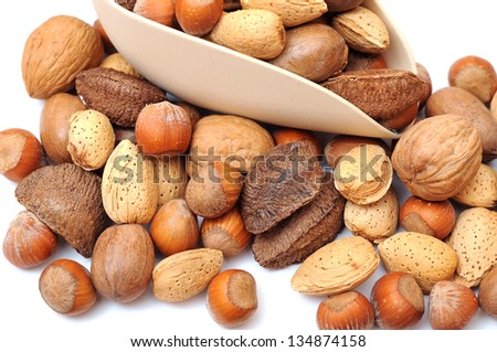 mix of nut in scoop on white background