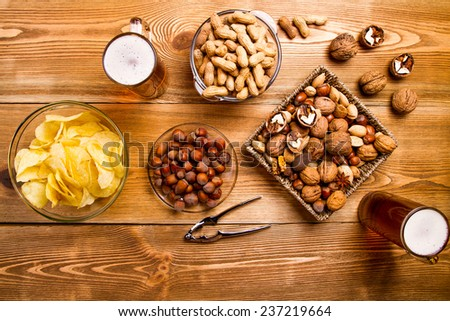 mix of nuts, snacks, chips - stock photo