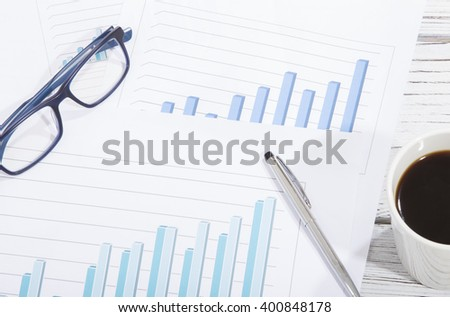 mix of office supplies and gadgets on a wooden table background. view from above - stock photo