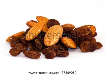 mix of raisinsand almond nut on isolated background - stock photo