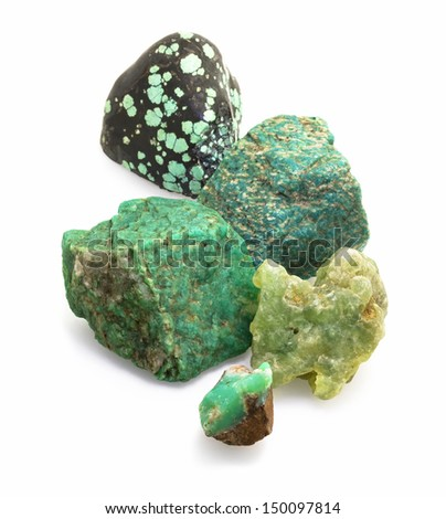 Mix of raw naturally green gems stones: amazonite, prehnite, chrysoprase and turquoise on white background. - stock photo