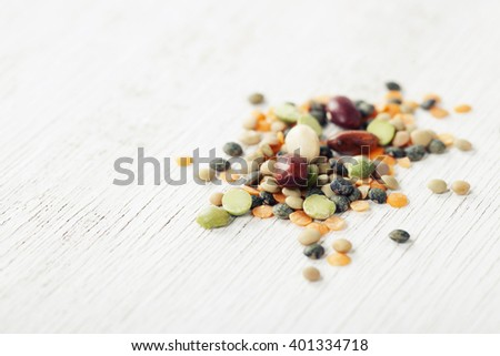 Mix of red  bean, lentil, green peas and chickpeas over white - stock photo