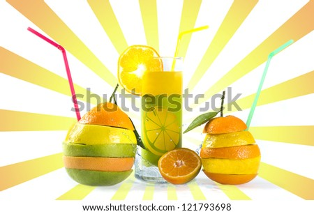 Mix of sliced citrus fruits and a glass of fresh juice - stock photo