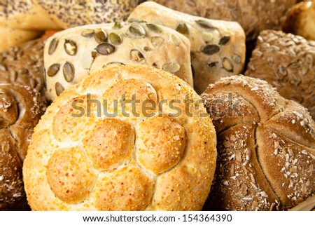 Mix of small breads on wood  - stock photo