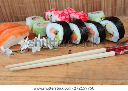 Mix of sushi with chopsticks - stock photo