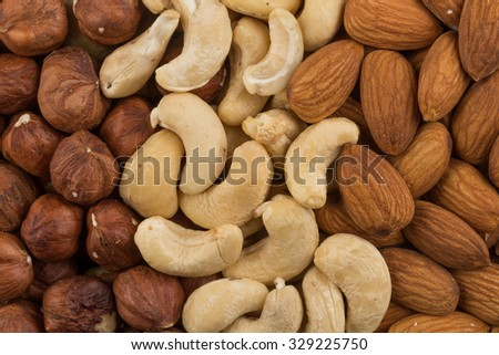 mix of various nuts background above closeup