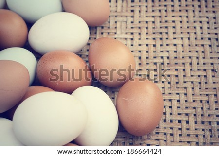 Mix of white and brown eggs in basket