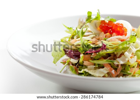 Mix Salad with Salmon and Quail Eggs - stock photo