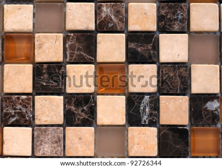 Mix stone and glass mosaic in brown tones - stock photo