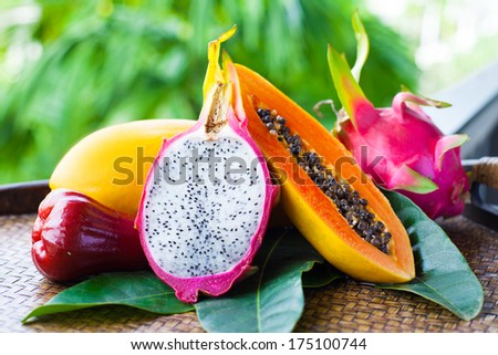 mix tropical fruits with leaves - stock photo