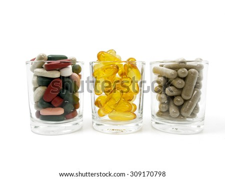 mix vitamin in glasses,Fish oil,vitamin,supplements,thai pepper,zinc,capsule isolated on white background,dietary supplement product,tablets - stock photo
