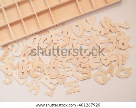 Mix wooden capital letters on the ground - vintage tone - stock photo