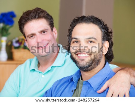 Mixed affectionate gay men embracing each other - stock photo