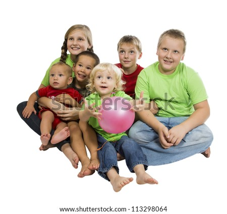 Mixed-age group of children sitting on something and watch with interest