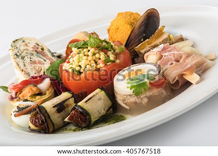 Mixed appetizers with meat, egg and vegetables