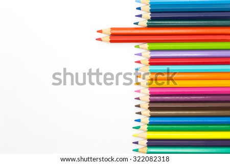 Mixed arranged of colours wooden pencils on white background