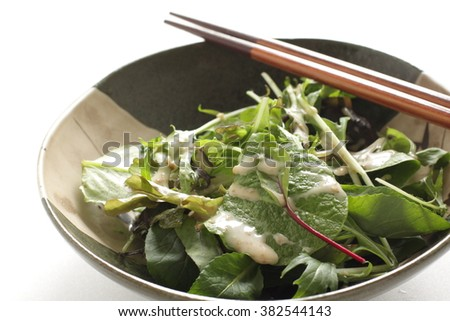 mixed baby leaf salad with sesame dressing
