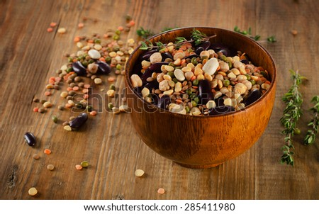 mixed beans, chickpeas  and lentils on a rustic  wooden table - stock photo