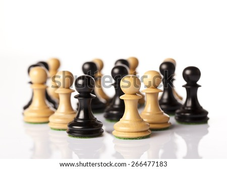 Mixed black and white chess pieces on white background