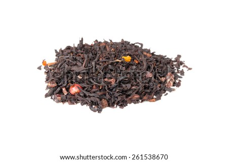 Mixed black Truffle tea with crushed cocoa beans, red pepper peas and dry fruits, small pile isolated on white, selective focus with shallow DOF - stock photo