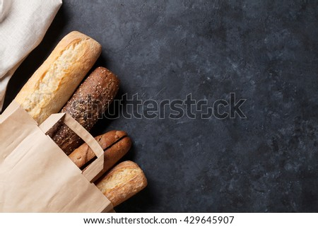 Mixed breads on stone table. Top view with copy space